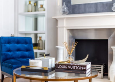 Interior Photography reception fireplace and coffee table-min
