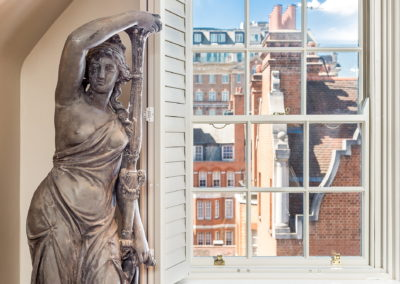 Interior Photography window view and statue-min